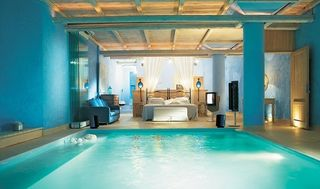 Interior_bedroom_swimming_pool_bed_blue_pool-abe7d20f36b574209e1d056486c634fa_h_large